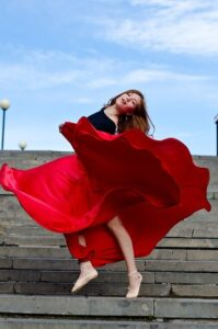 Dancing Girl in Red Skirt